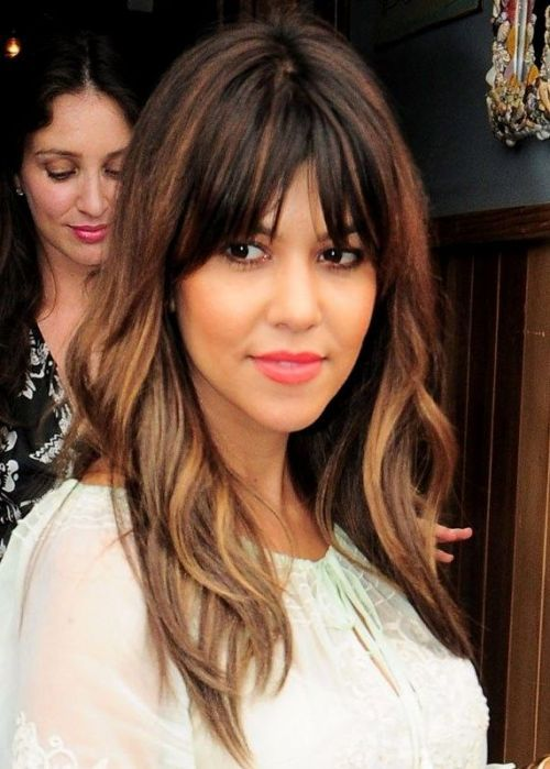 I love this look for the color and the cut...even if it who they say (Kourtney Kardashisn!) It looks gorgeous with her tousled, streaked layers and a long piecey fringe. The caramel brown streaks give her hair a contemporary lift, accentuating her layers and brightening up her complexion. Once you have your layered haircut, consider adding high- and low-lights to bring your locks to life.
