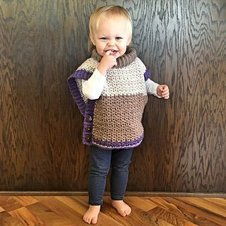 This poncho sweater is light, warm, versatile and so easy to make! Using Caron Cakes yarn creates a fun color-block appearance, but this would also look great in solid colors!