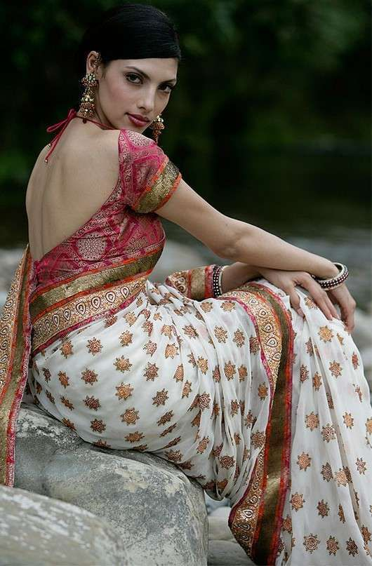 The Indian choli is a short midriff-baring top worn with either sari or lehenga alos called a blouse. It can be quite a versatile garment, which can be adapted to a variety of styles. Since usually the front of the blouse is covered using a dupatta or in the case of a saree the Pallu. So essentially Choli's have elaborate backs.