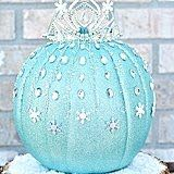 Be the envy of every home on your block when you create this glistening DIY Elsa pumpkin, complete with a crown and snow-capped pedestal.