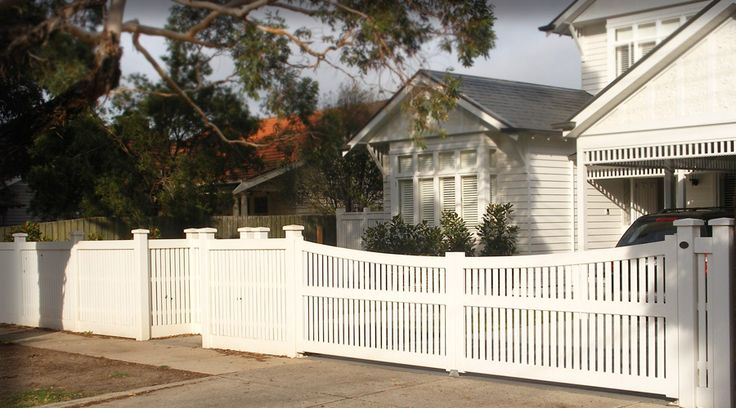 Step fence includes a Hampton Configuration with a Recess Gate, C5 styled Captials and custom made swing Gate