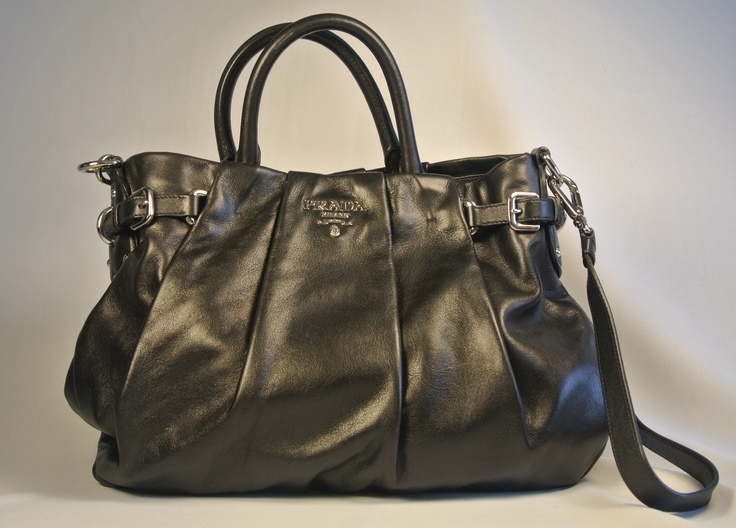 Absolutely Stunning Prada!! Check it out at www.designerShare.ca and the rest of our beautiful pre loved handbags