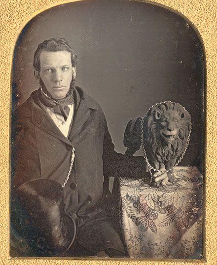 ca. 1840's, [daguerreotype portrait of gentleman with lion statuette in chains] via Christopher Wahren Fine Photographs