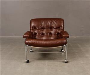 Vara: 4269944AB Lindlöfs möbler, Fåtölj i läder med kromad Stomme, 70-tal