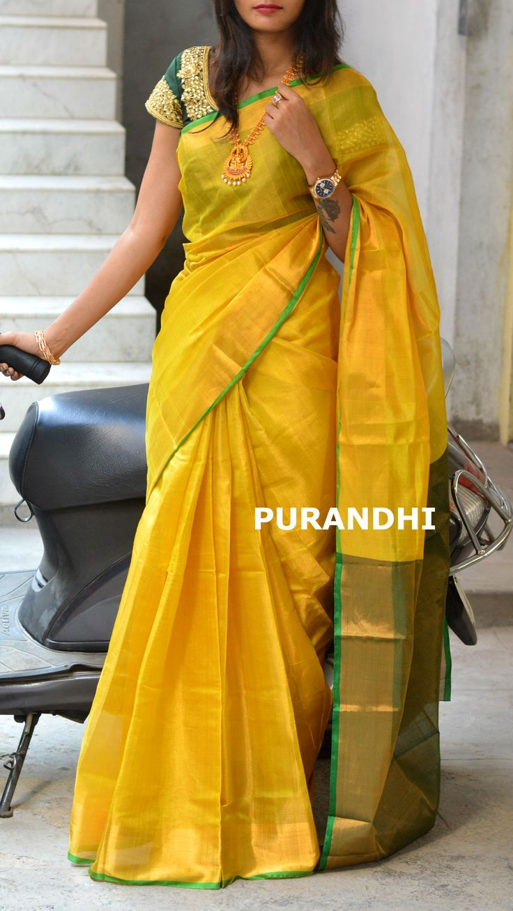 Yellow and Bottle green uppada tissue saree. For more details please contact us on whats app : 9701673187  Email : purandhistore@gmail.com