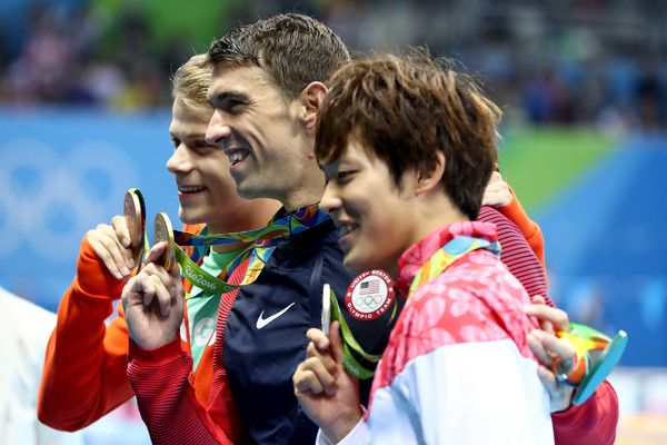 (L-R) Bronze medalist Tamas Kenderesi of Hungary, Michael Phelps of the United States and silver medalist Masato Sakai of Japan pose on the podium during the medal ceremony for the Men's 200m Butterfly Final on Day 4 of the Rio 2016 Olympic Games at the Olympic Aquatics Stadium on August 9, 2016 in Rio de Janeiro, Brazil.