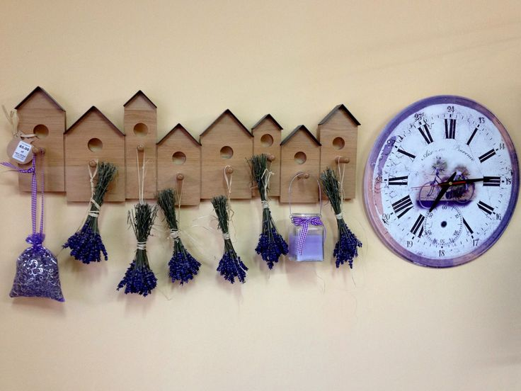 Wall hanger and clock in the shades of purple with pot pouri and composition of cereal