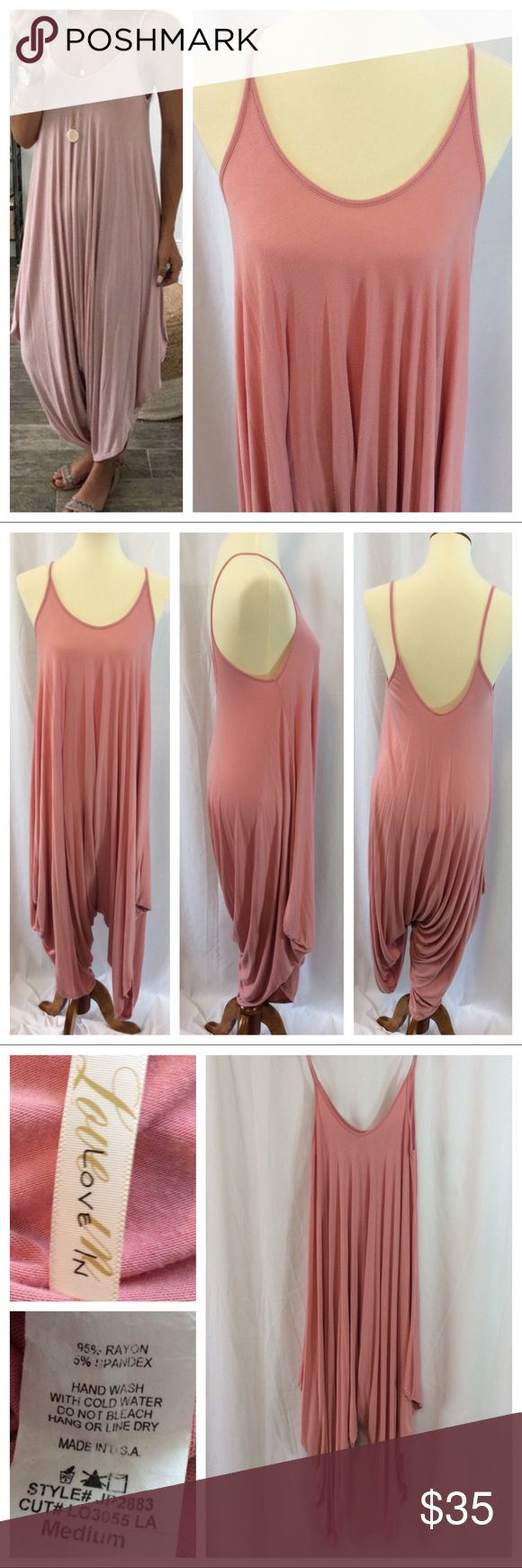 """Love In Harem Romper This loose fitting jumper is the definition of comfort. Pull on design with spaghetti straps, loose front and back neckline and allover wide fit. The rayon/spandex fabric blend lays beautifully. Mauve color. Size M, approximately 19"""" chest when laying flat. Great condition. Pants Jumpsuits & Rompers"""