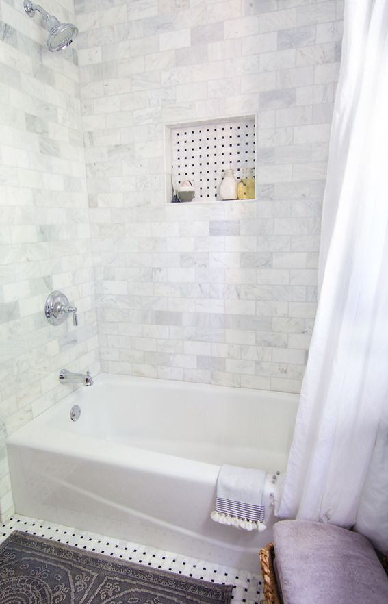 this marble tile will be great as a tub surround light and airy but not