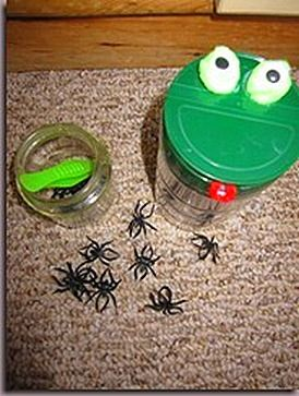 Tweezing spiders (feeding the frog). I saw this idea featured at Living Montessori Now Leap Year activities post from The Preschool Experiment (she has such a great Pond unit post). This is an empty parmesan cheese container. I glued two green pom-poms, two googly eyes and a piece of red felt.