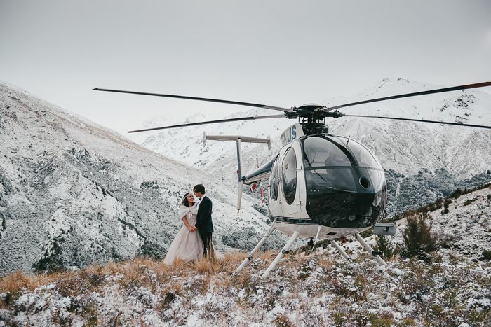 Reach your secluded elopement destination in style by traveling via helicopter | image by Carla Mitchell Photography #winterwedding #winterelopment #destinationwedding #destinationelopement #amazingweddingphotos