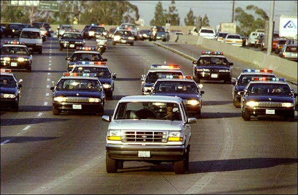 """06/17/94 - OJ Simpson and the famous """"Ford Bronco Chase"""".  Simpson agreed to turn himself in but failed to do so.  Someone saw him riding in his Bronco with a gun pointed to his head.  His friend drove 35 mph while 20 police cars followed."""