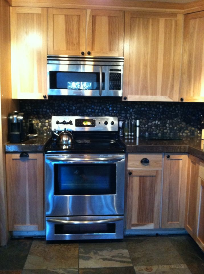 hickory cabinets concrete countertops and river rock backsplash