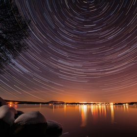 Spinning stars over Lac-Megantic ~ As time goes by, the earth slowly rotates on itself and creates the illusion that we kept for so long : the heavens seems to spin around us, on and on and on...by Remi Boucher