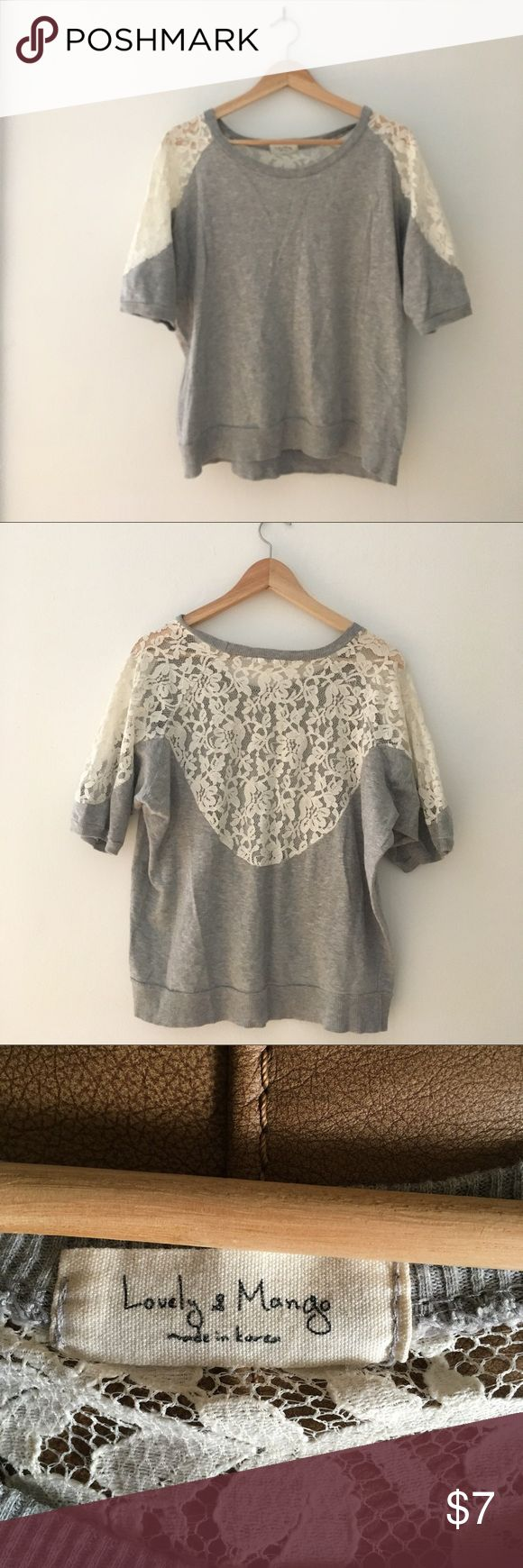 Lace Back Grey Tee Sz L This cute tee is grey with a white lace back. No size tag, but like a Sz L. Lovely and Mango brand, bought in Korea. lovely and mango Tops Tees - Short Sleeve