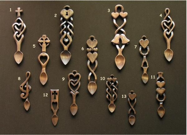 The Lovespoon Gallery in Mumbles offers hundreds of designs from individual carvers. http://www.lovespoons.co.uk