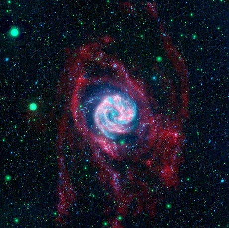 "An image released by NASA in April shows baby stars taking shape in the Southern Pinwheel galaxy.    Embryonic stars were found to be growing in the galaxy's spindly arms (shown in red), rather than in its bright heart.    Scientists at the time described the find as ""absolutely stunning,"" because it was believed that such outlying sections of galaxies lacked the necessary materials for star formation."