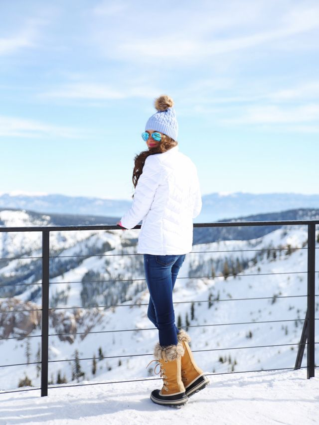 pink cashmere sweater , less expensive version here  // white North Face jacket   blue pom pom beanie ...