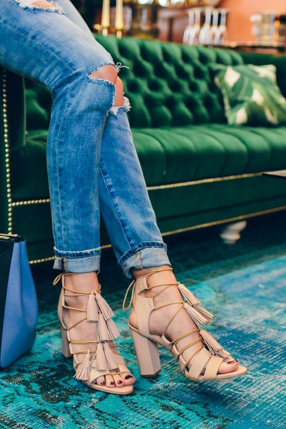 Ripped jeans and beautiful sandals.