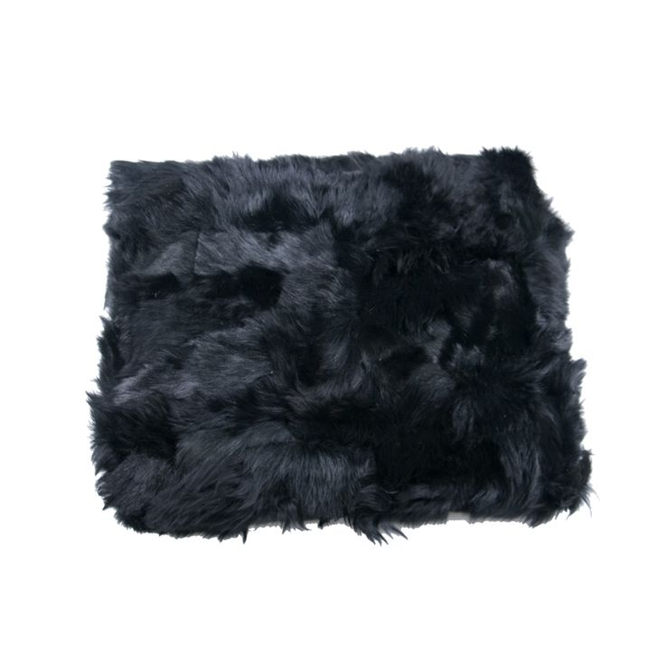 Plaid black leather A decorative rug from black leather with fur. Hand sewed.  Recently fur accessories have become very trendy. Several furry cushion covers on a sofa or an armchair can change an austere room to a more friendly space. Featuring dark tones and a plush texture, it perfectly matches neutral fabrics and bare wood to complete the look .