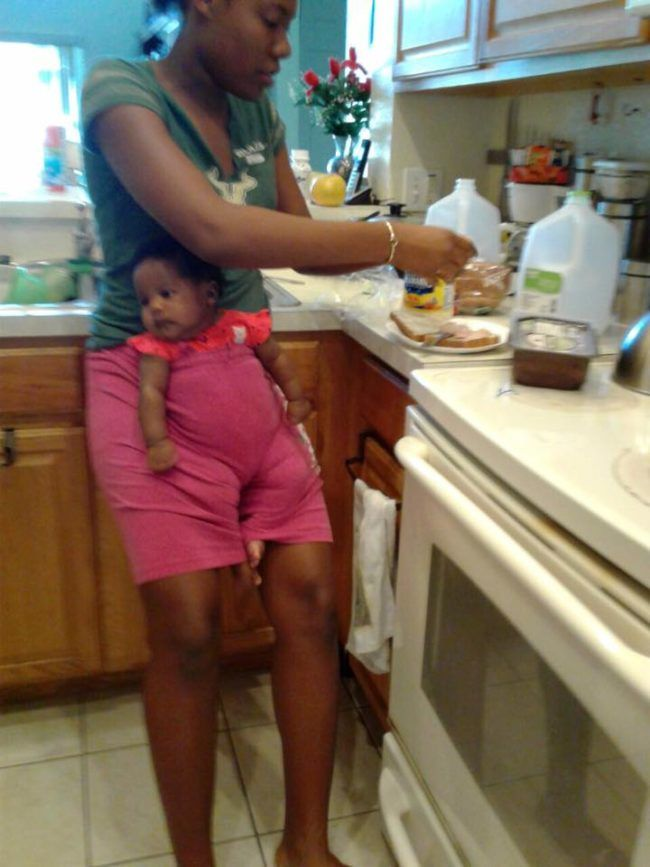 """J'Ann wanted to make a sandwich, but she didn't want  to leave the baby alone. That's when she tucked her securely into the front of her shorts. """"Lord send help this was her solution,"""" Sorhaindo <a href=""""https://www.facebook.com/photo.php?fbid=10154396051380735&set=pcb.10154396055225735&type=3&theater"""" target=""""_blank"""" data-beacon='{""""p"""":{""""mnid"""":""""entry_text"""",""""lnid"""":""""citation"""",""""mpid"""":4,""""plid"""":""""https://www.facebook.com/photo.php?fbid=10154396051380735&set=pcb.101543960..."""