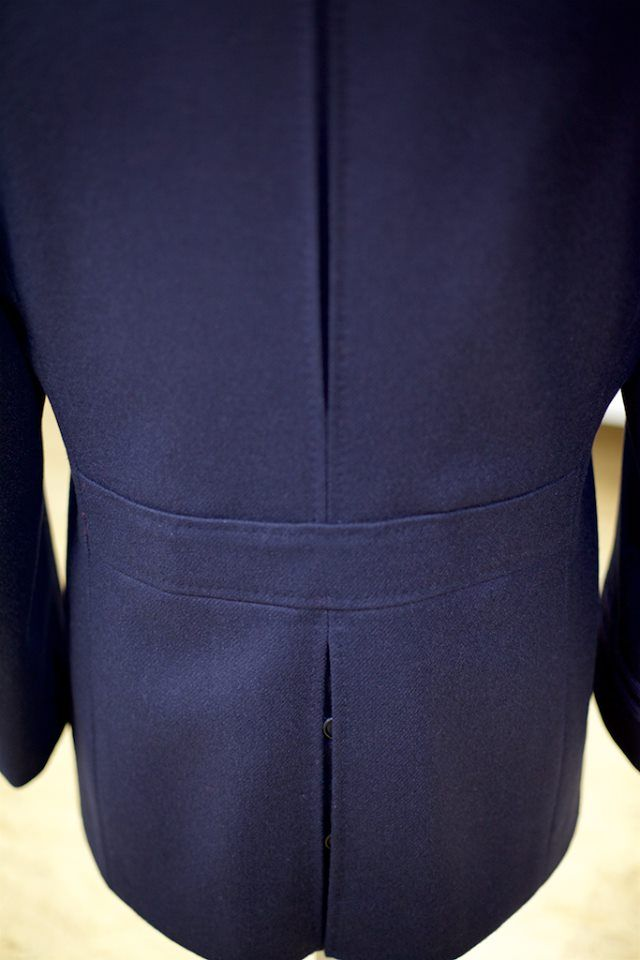 This classic, Naval Pea Coat features an 'action back' in the upper section and, below the belt, a buttoned double-vent.