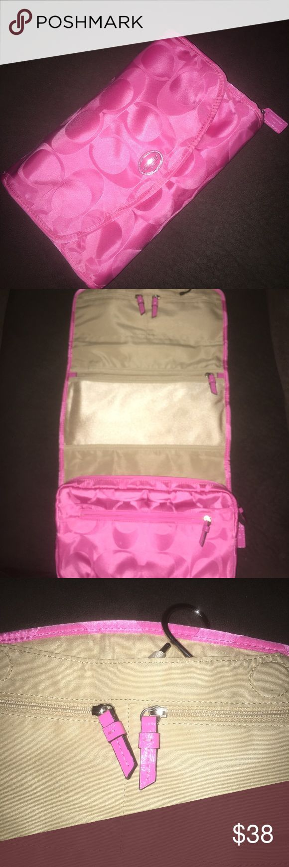 Coach Signature Travel Case Hanging case perfect for jewelry and small accessories during travel. Could also be used as a toiletry bag. In excellent condition. Coach Accessories