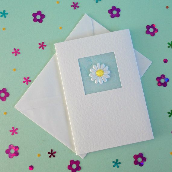 Wedding Day Card, white daisy flower - pale blue, Card for Bride and Groom, Happy Couple, Wedding Congratulations, modern, contemporary, cute. Simplicity is the key to this elegant handmade card. A white, subtly textured cardstock is used as the base, mulberry paper for a colour accent and finished with a pretty, cute daisy flower. Supplied with printed paper insert and matching envelope. Background mulberry paper colour: * Pale blue Flower: * White daisy flower with yellow centre Wording…