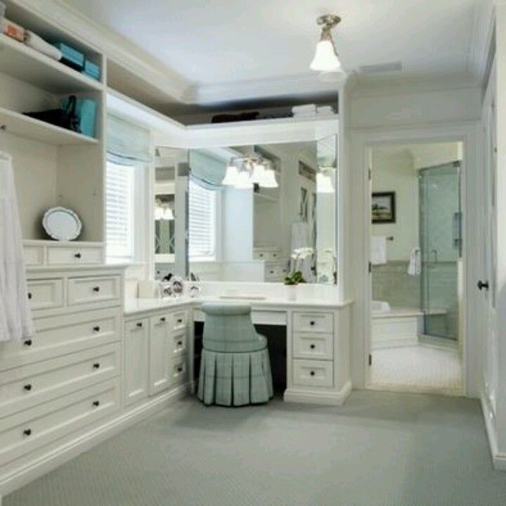 Closet and makeup station that leads to the bathroom. Lovee.