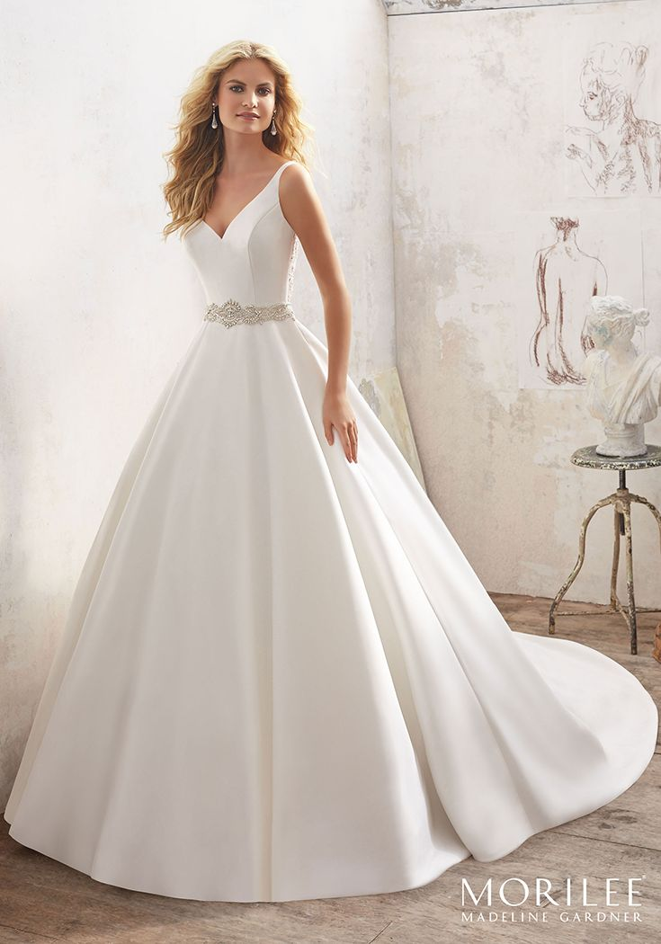 Morilee by Madeline Gardner 'Maribella' 8123 | Understated and Elegant, This Stunning Marcella Satin A-Line Bridal Gown Features a Crystal Beaded Sheer Back and Waistline. Covered Buttons Trim the Back and Train. Available in White/Silver, Ivory/Silver. Shown in Ivory/Silver.