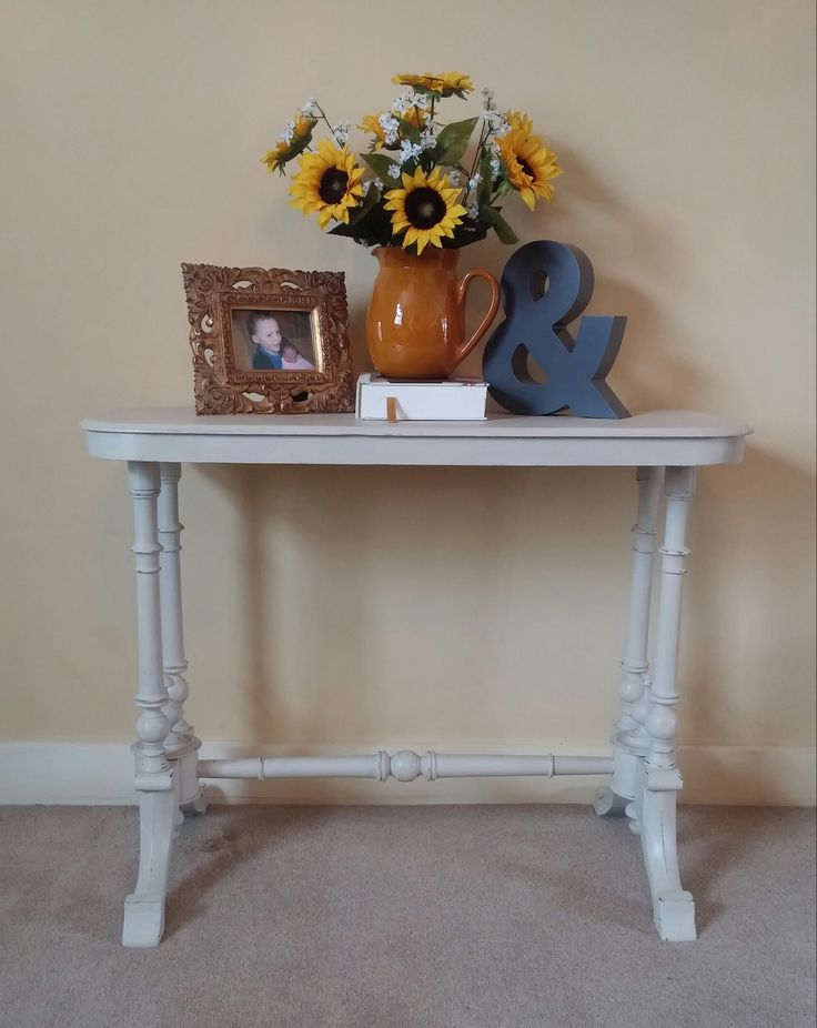 SOLD This is an upcycled, Victorian, stretcher Console Table. The colour is an off-white, with distressed shabby chic finish to the legs. This table can be used as an entry table in the hall, in the sitting room for a statement lamp, in an inglenook, or recess for a vase of flowers. the legs are beautiful and this whole piece is already a piece of art. Length: 88cm, Width: 42cm, Height 67cm.