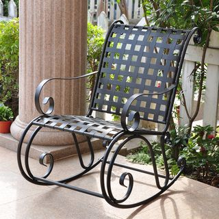 Finely crafted of sturdy wrought iron, this beautiful black rocking chair is sure to be an instant favorite on your patio, front porch or any outside setting. Its classic lines and carefully worked la