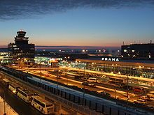 Overview of Václav Havel Airport Prague at night, Terminal 2 behind control tower on the left and Terminal 1 on the right