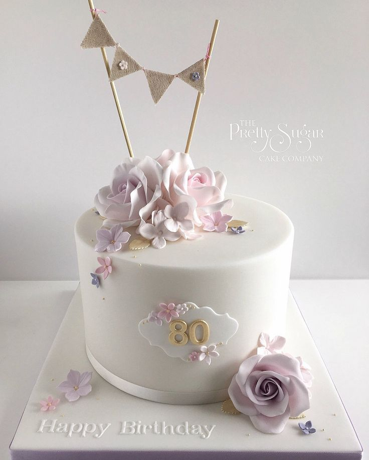 Pink,lilacs and gold vintage style 80th birthday cake with sugar roses and bunting detail