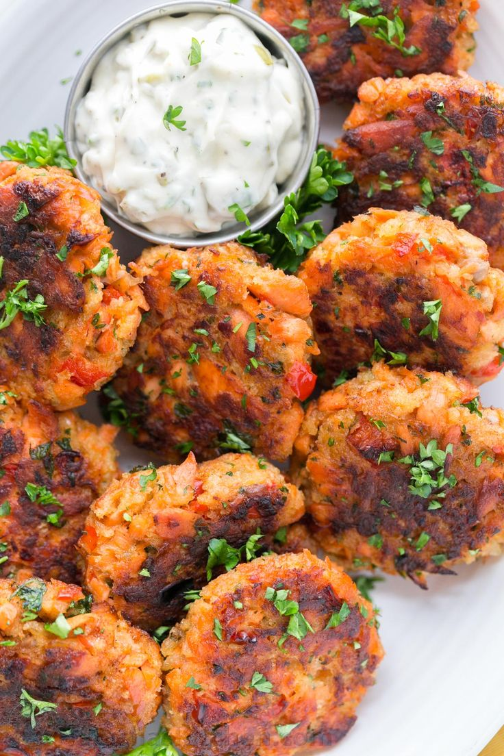 These salmon cakes are crisp on the outside with tasty bites of flaked salmon. They always disappear fast! SUPER EASY and truly delicious salmon cakes! | natashaskitchen.com