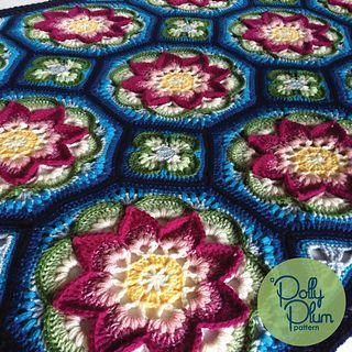 This bright cheerful afghan with large floral motifs is a show stopper. It is rich in texture, character, and possibility. Endless color combinations can be used to create different floral effects. The gentle cupping of the petals adds subtle dimension and interest, and the framing of the individual motifs gives a tile-like effect.