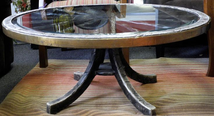 The 25 best wagon wheel table ideas on pinterest g wagon cost wagon wheel decor and wagon wheel Antique wheels for coffee table