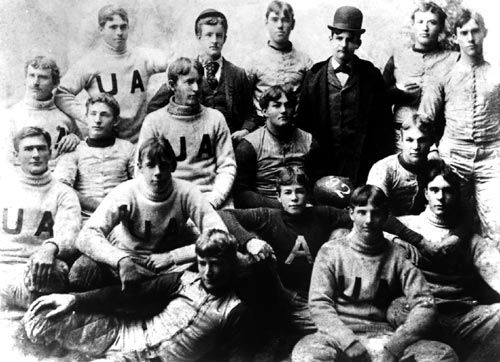 See the guy wearing the bowler hat? That's E.B. Beaumont, Alabama football's first coach. He went 2-2-0 in his one year coaching career.