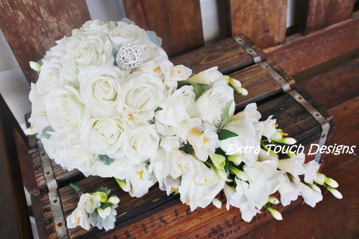 Artificial Teardrop bouquet of cream roses and freesias with a heart diamonte brooch.