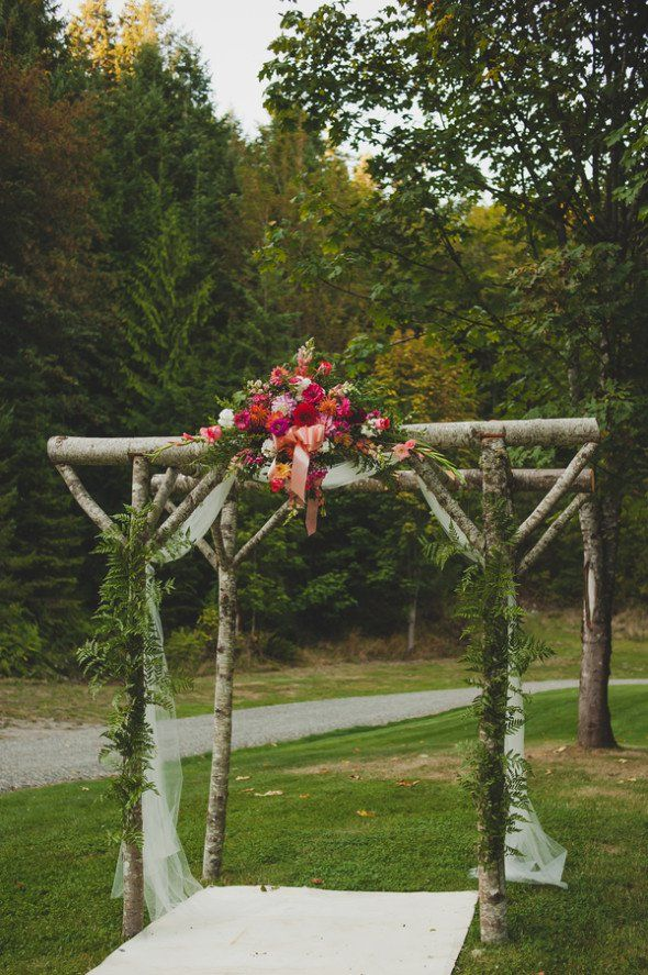 Rustic Tree Log Arch For an Outdoor Cabin Wedding.