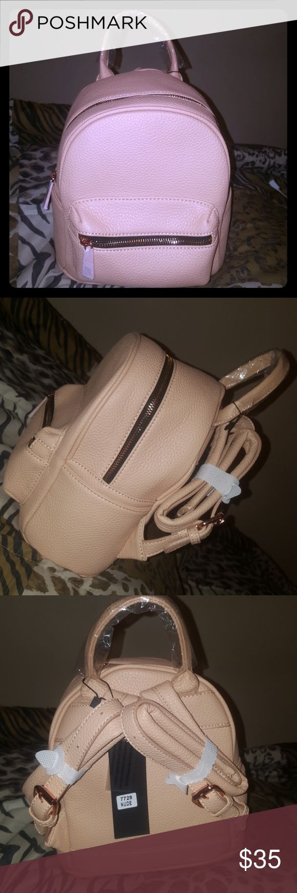 Blush Pink & Rose Gold Backpack Small Blush Pink & Rose Gold Backpack with 2 side pockets & 3 inside compartments along with front zipper pocket Bags Backpacks