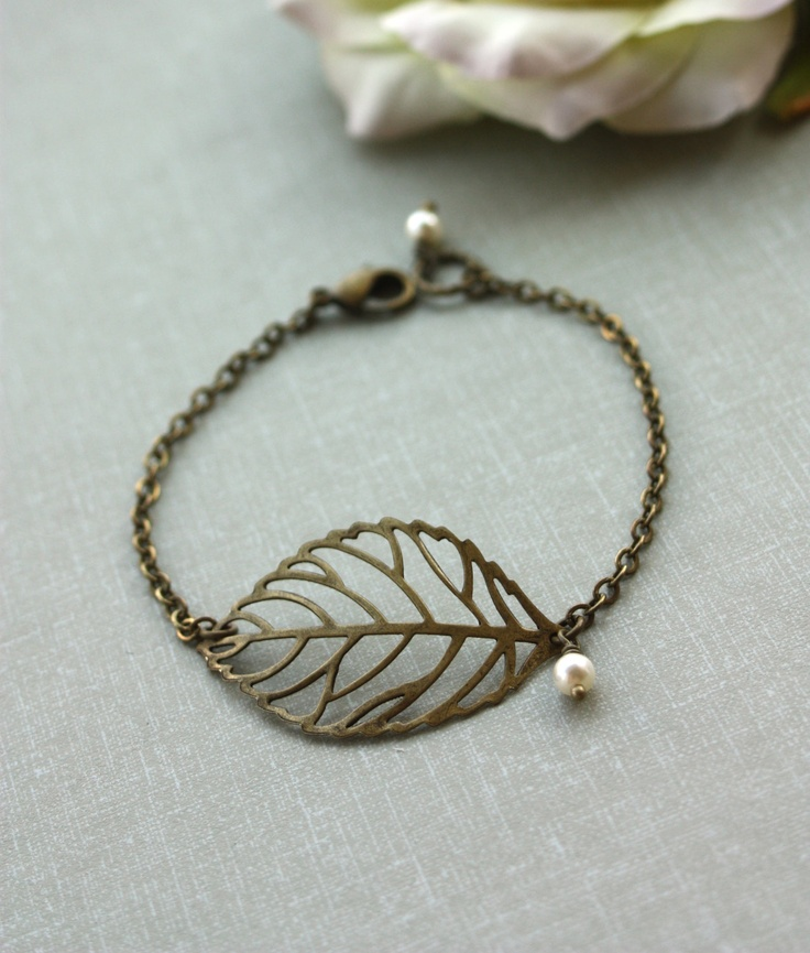 An Antiqued Brass Leaf, Ivory Cream Pearls Bracelet. Wedding Jewelry.Maid Of Honor. Bridesmaids Bracelet. Bridesmaid Gifts. For Sister.. $20.50, via Etsy. - Yet another bridesmaid gift idea.