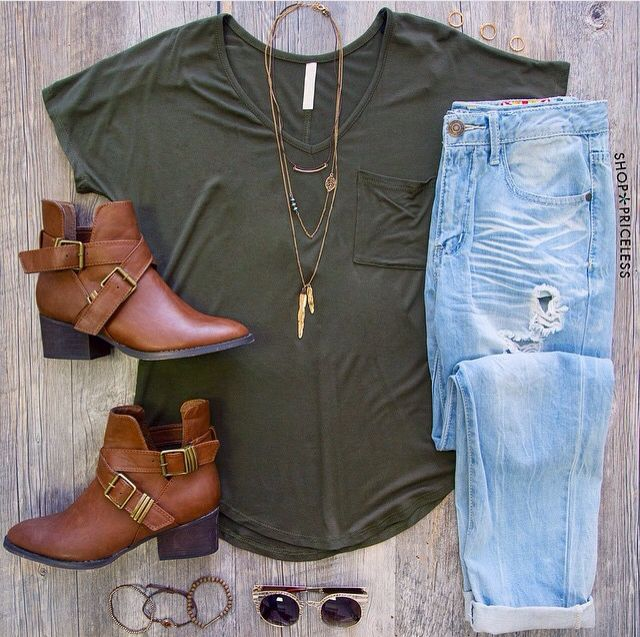 Basic olive-green top with a pair of light washed jeans and brown booties.