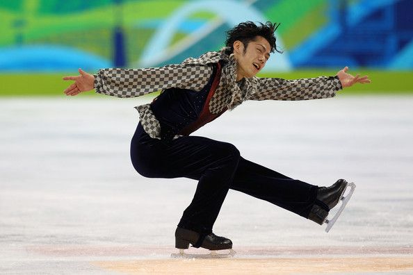 Daisuke Takahashi Photos Photos - Daisuke Takahashi of Japan ompetes in the men's figure skating free skating on day 7 of the Vancouver 2010 Winter Olympics at the Pacific Coliseum on February 18, 2010 in Vancouver, Canada. - Figure Skating - Day 7