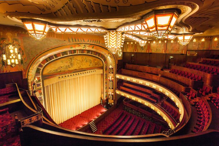 the Tuschinski movie theater in Amsterdam, the Netherlands, built in 1921. The…