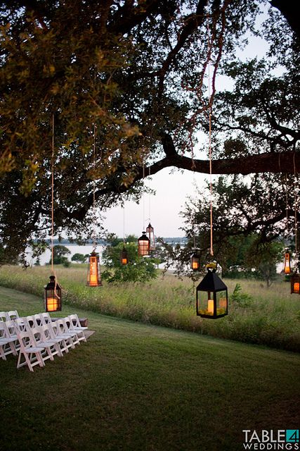 Love the feel of getting married under a tree with lanterns hanging from the branches