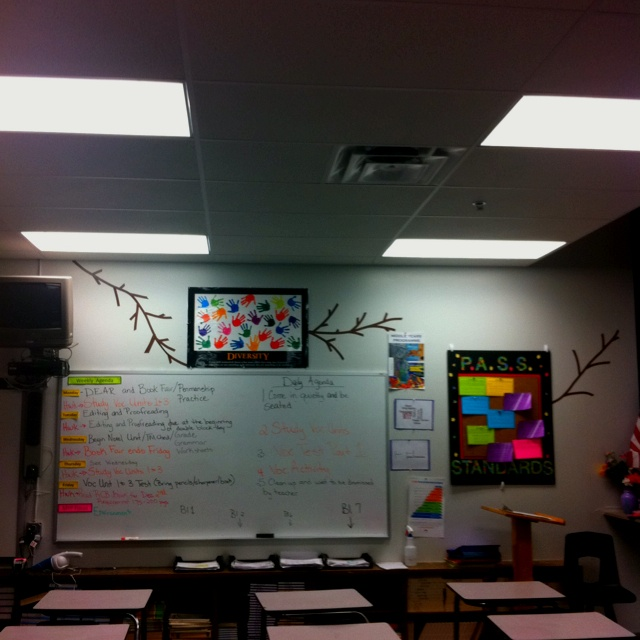I have a bulletin board made out of poster board, cork-board squares, electrical tape, and scrapbook cut out letters. Tree branches made from electrical tape.