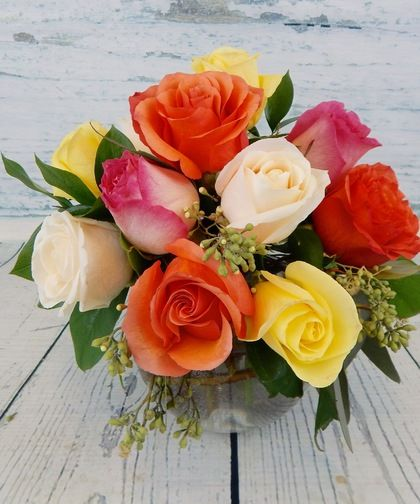 Rose Sorbet-A unique twist on a classic...Designer select, assorted colored roses in various hues create a unique and beautiful display in a bubble bowl vase with delicate greenery. #BagoysFlorist #AnchorageFlowers #MothersDay #MothersDayGifts #MothersDayFlowers