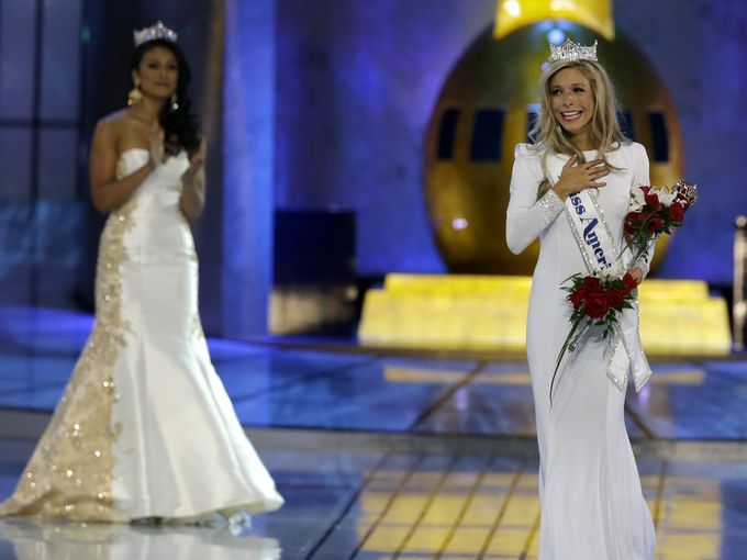 Miss New York Kira Kazantsev, right, walks the runway after she was named Miss America 2015 during the Miss America 2015 pageant, Sunday, Sept. 14, 2014, in Atlantic City, N.J. Miss America 2014 Nina Davuluri, left, who was also once Miss New York, looks on during the walk. (AP Photo/Mel Evans)