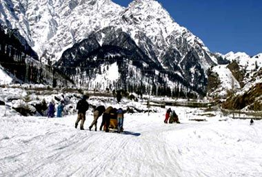 Located in the Beas Valley, towards the north of Kullu Valley, the scenic hill station of Manali was once the starting point of an ancient trade route to Ladakh, and onwards over the Karakoram Pass to Yarkand and Khotan (former stops on the Silk Road, now in China's Xinjiang province). The town is packed with holiday-makers during season, and the villages around – including blissed out Old Manali – are a magnet for hippie tourists.  Surrounded by dense pine forest, fruit g...